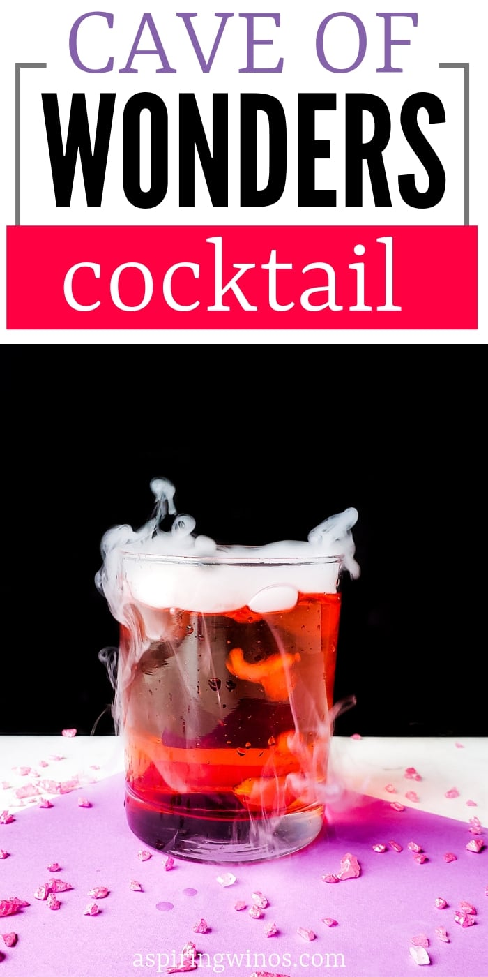 Cave of Wonders Cocktail Recipe with Dry Ice | Inspired by Aladdin, this fun pineapple cocktail has major party wow factor. It includes vodka and cherry liqueur, with dry ice making it a party pleaser, even better for a Halloween night. #cocktail #vacationcocktail #drinkrecipe #pineapplecocktail