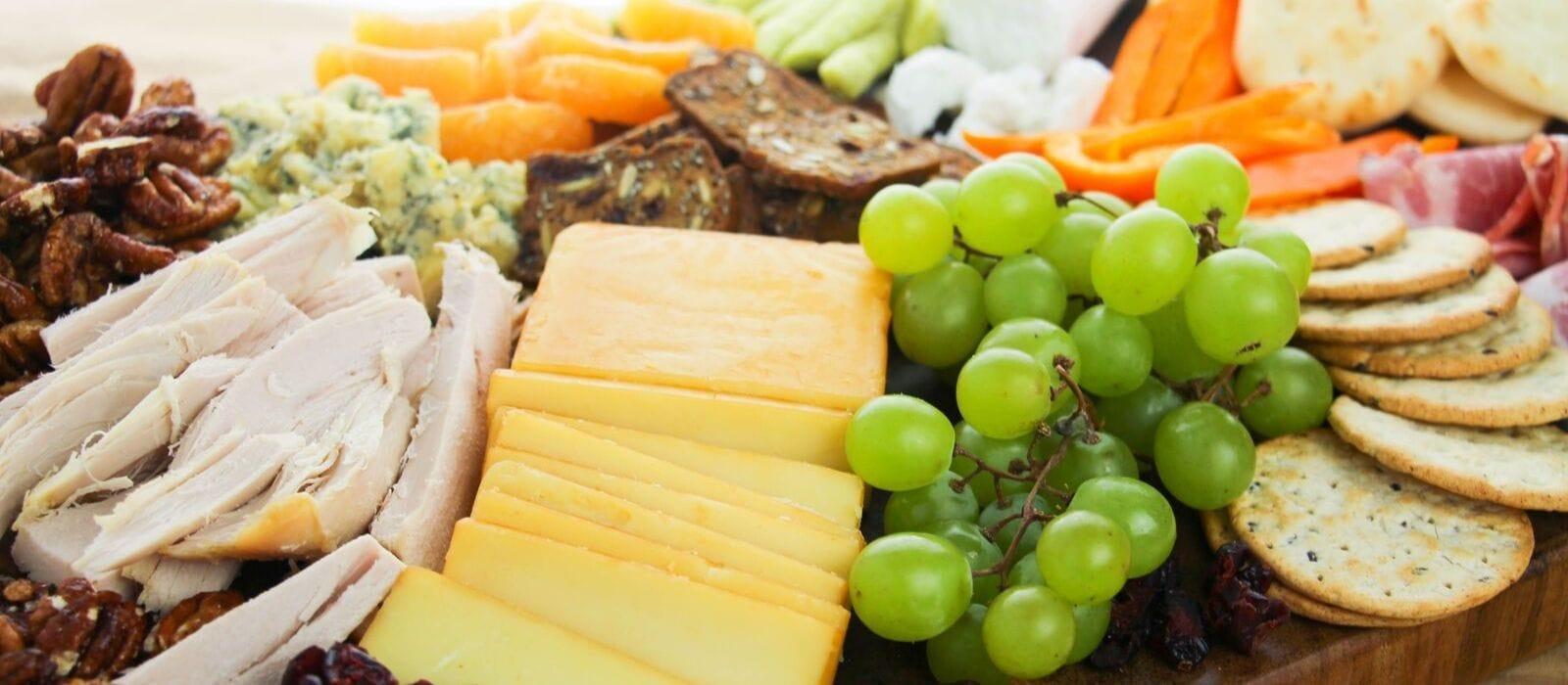 How to Make a Fall Cheeseboard = horizontal close up of green grapes and cheeses