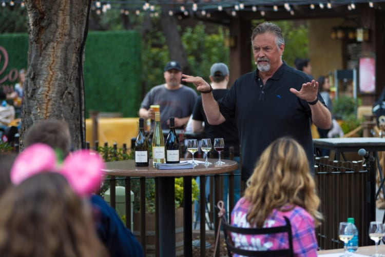 Disney Food & Wine Festival - guy talking and explaining a flight of wine standing next to a table