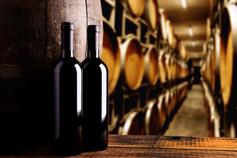 Lodi wine visitors center wine bottles next to wine barrel cellar