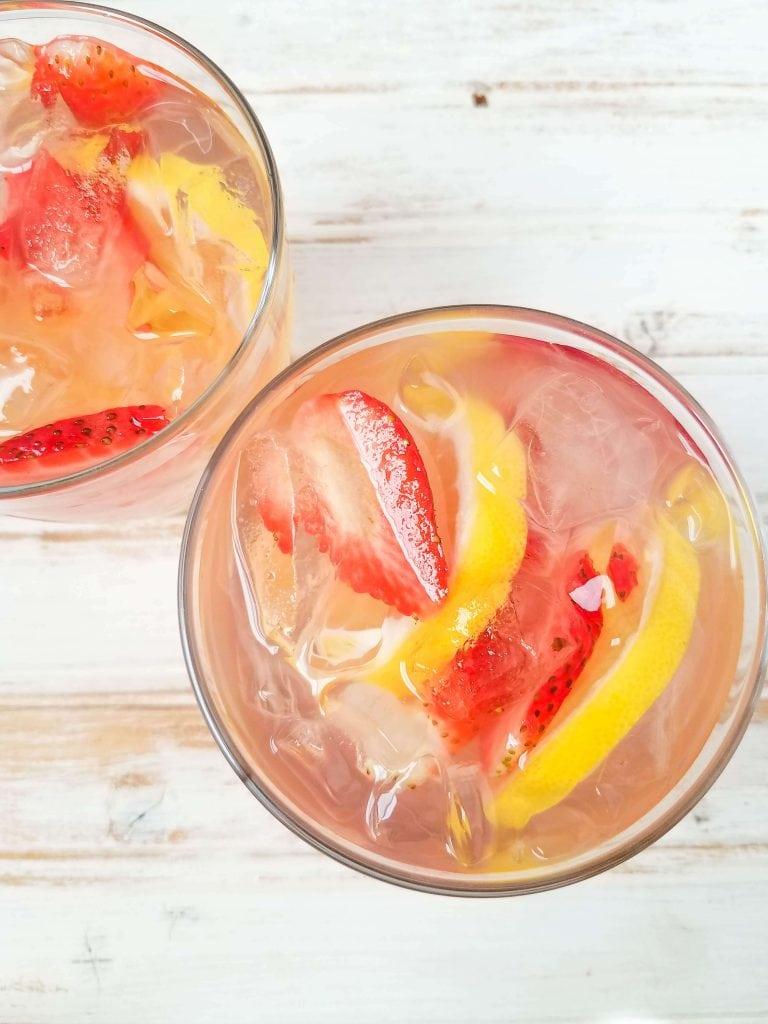 Pink Lemonade Moscato - glinting ice and sliced fresh fruit in alcoholic lemonade