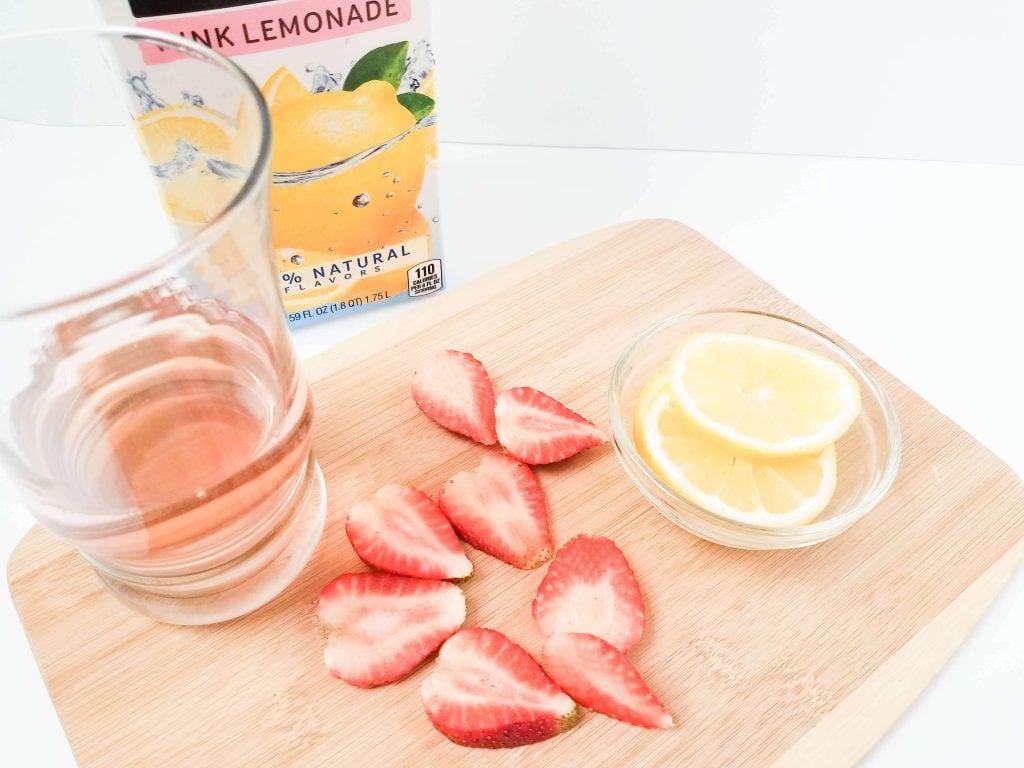 Pink Lemonade Moscato - ingredient shot with pink lemonade, strawberries and sliced lemons