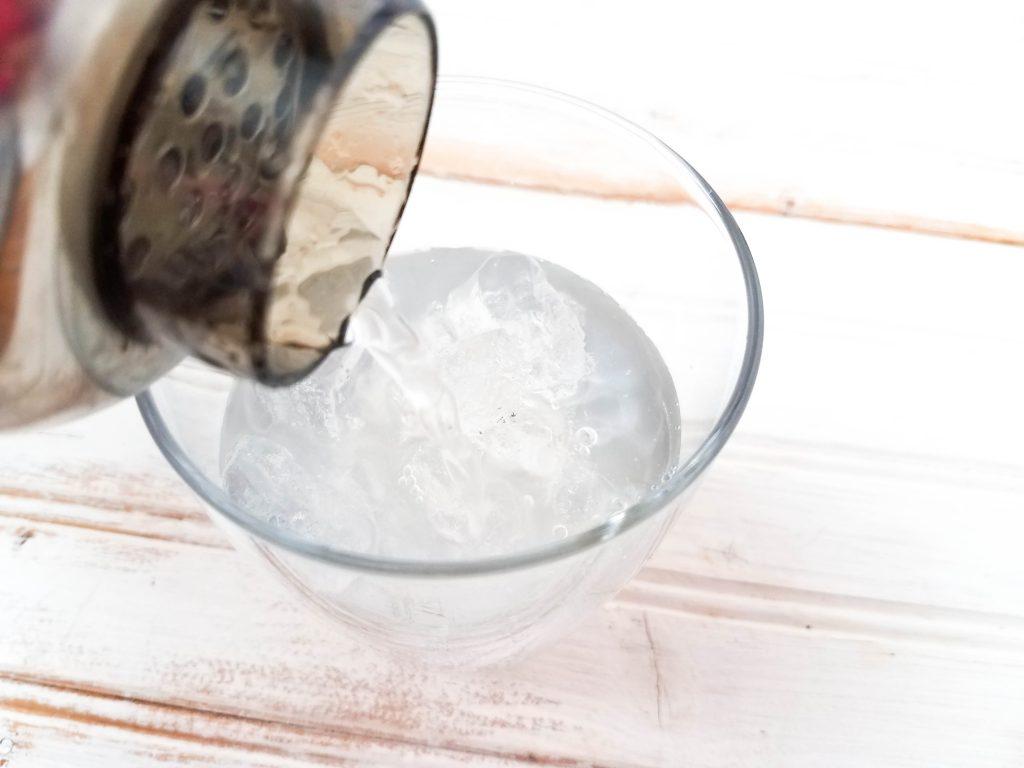 Pour Vodka Lemonade Cocktail into glass