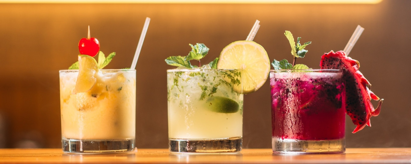 Non-Alcoholic Drinks - 3 glasses in a row of pretty looking cocktail juices