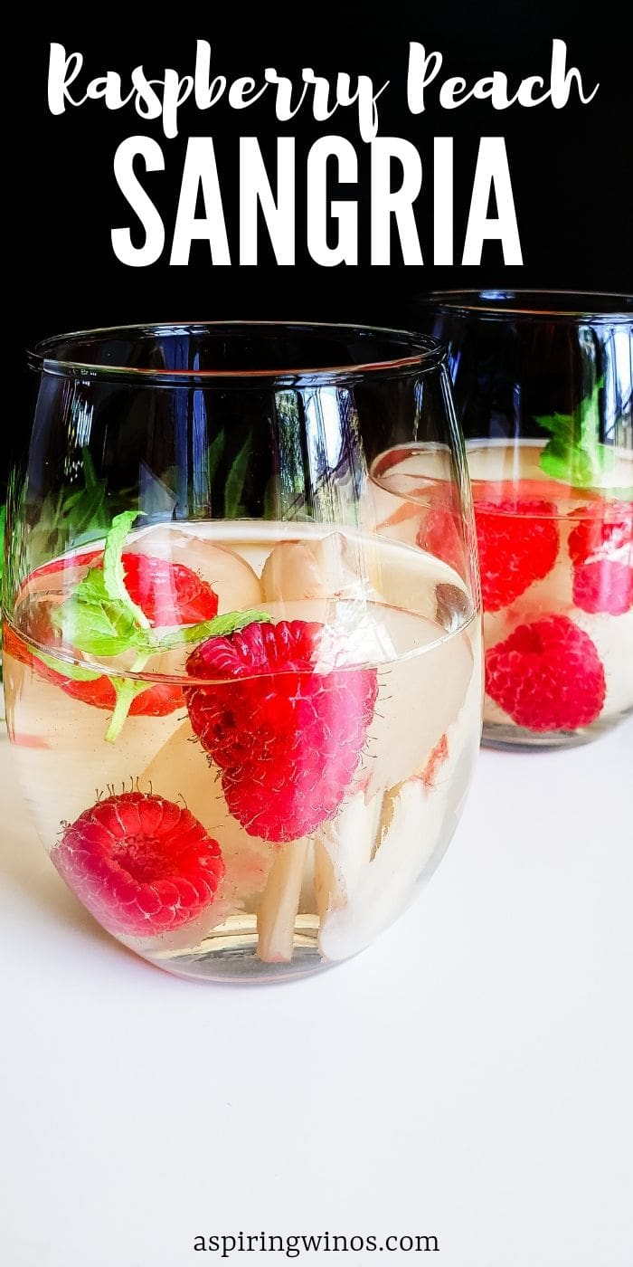 Mix up a big pitcher of this refreshing Raspberry Peach Sangria to enjoy on the patio in the summer weather. Raspberry Peach Sangria: Choose Your Own Wine| Raspberry Peach Sangria| Peach and Raspberry Sangria | Sangria Cocktails| Wine Cocktails  #wine #cocktails #sangria #summerdrinks