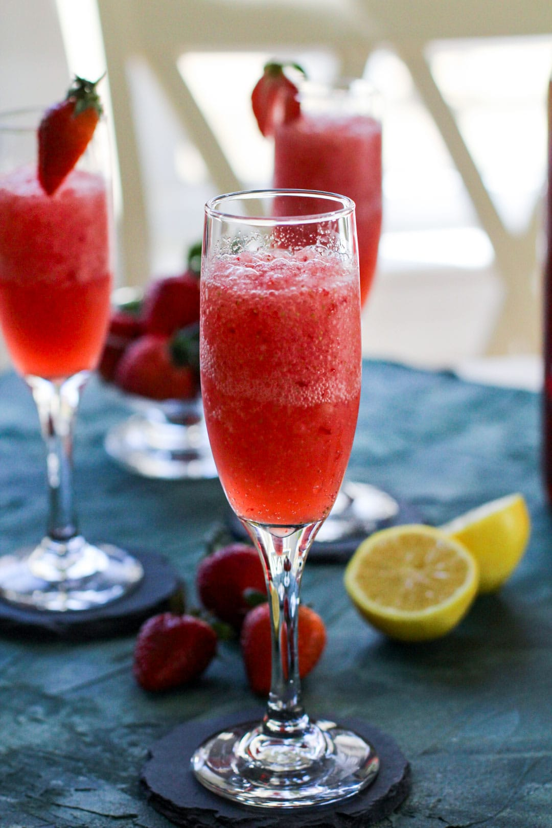 strawberry froze glasses on slate coasters