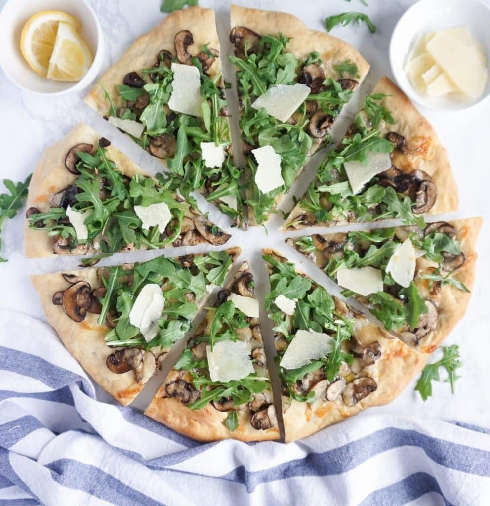 Our Favorite Mushroom Dishes To Pair With Pinot Noir - Arugula Mushroom Pizza
