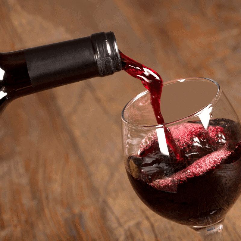 Glass of red wine being poured for Revel wine tasting in Tucson Arizona