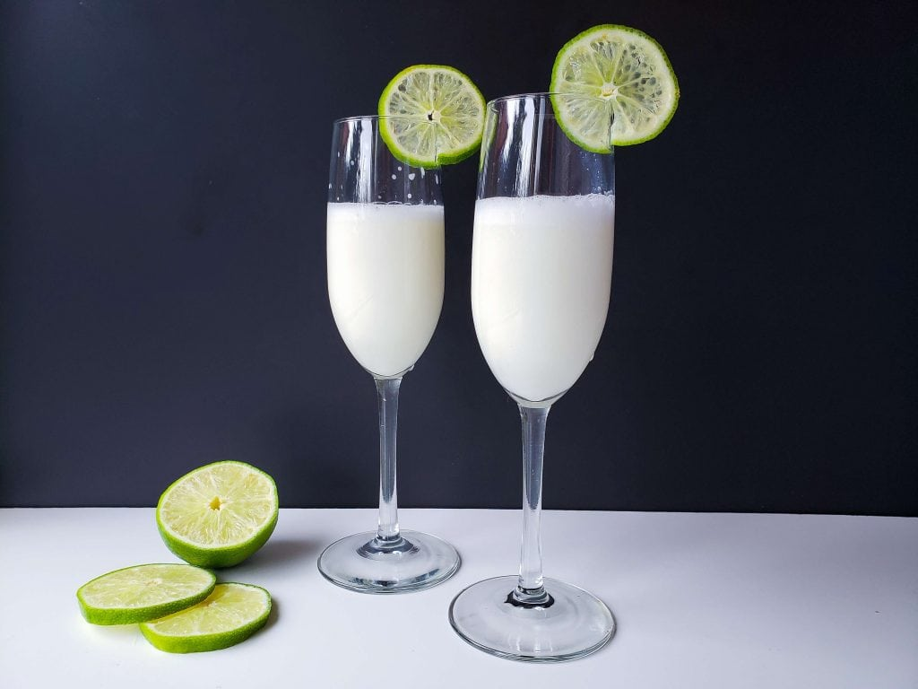 Creamy Margarita Cocktail Recipe - Finished drinks garnished with fresh lime slices