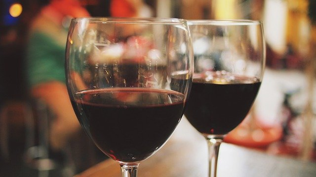 Two glasses of red wine in a Tucson Ventana winery tasting room
