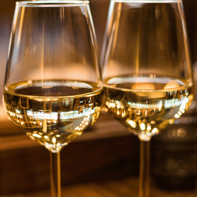 Two glasses of white wine in a tasting room